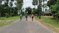 Cyclists on the road in Myanmar |  <i>Kate Harper</i>
